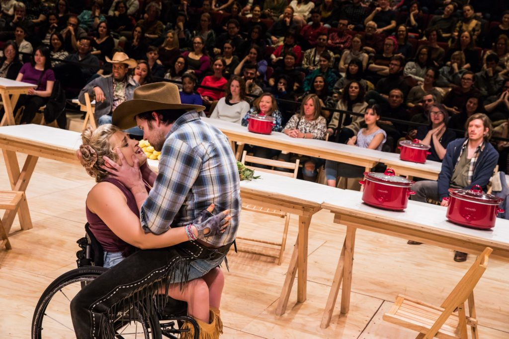 "James Davis as Will Parker sits on Ali Stroker as Ado Annie's lap in ""Oklahoma!"" on Broadway"