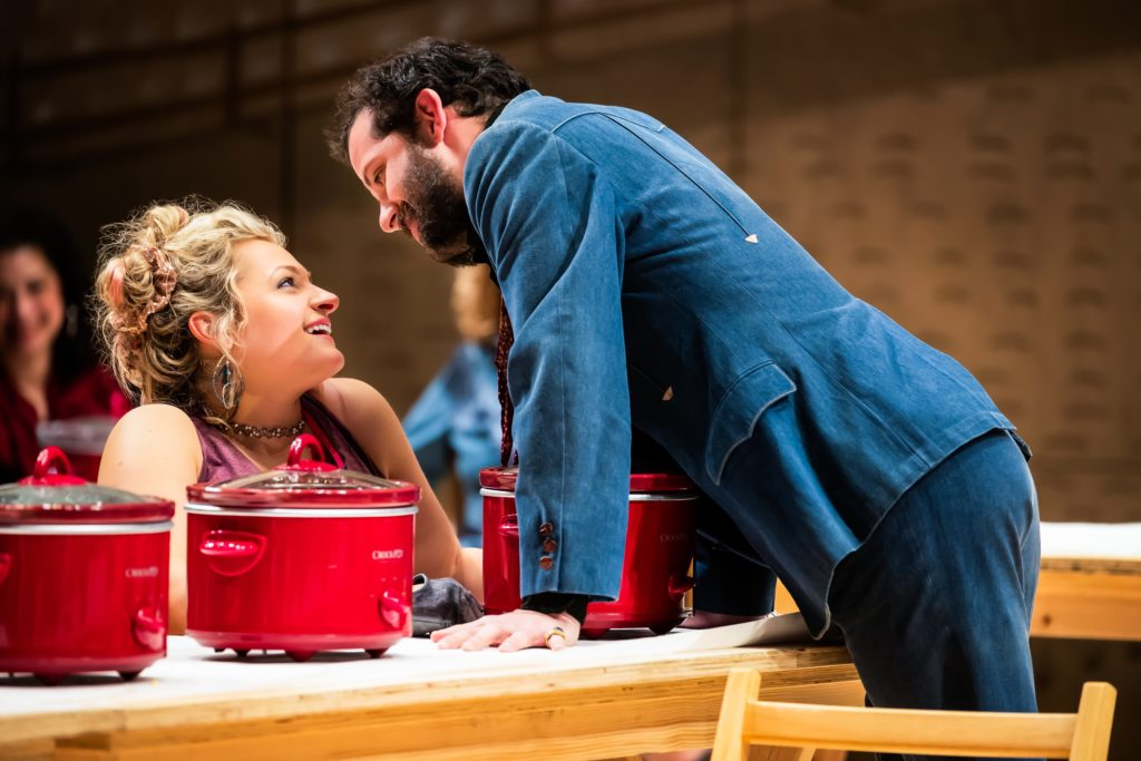 "Will Brill as Ali Hakim leans over Ali Stroker as Ado Annie in ""Oklahoma!"" on Broadway"