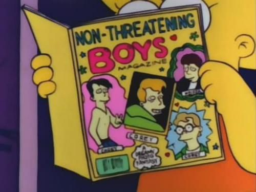 Lisa Simpson holds a copy of Non-Threatening Boys Magazine