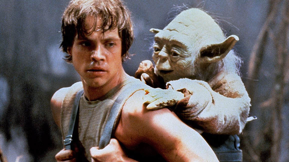 Luke Skywalker carrying Yoda on his back