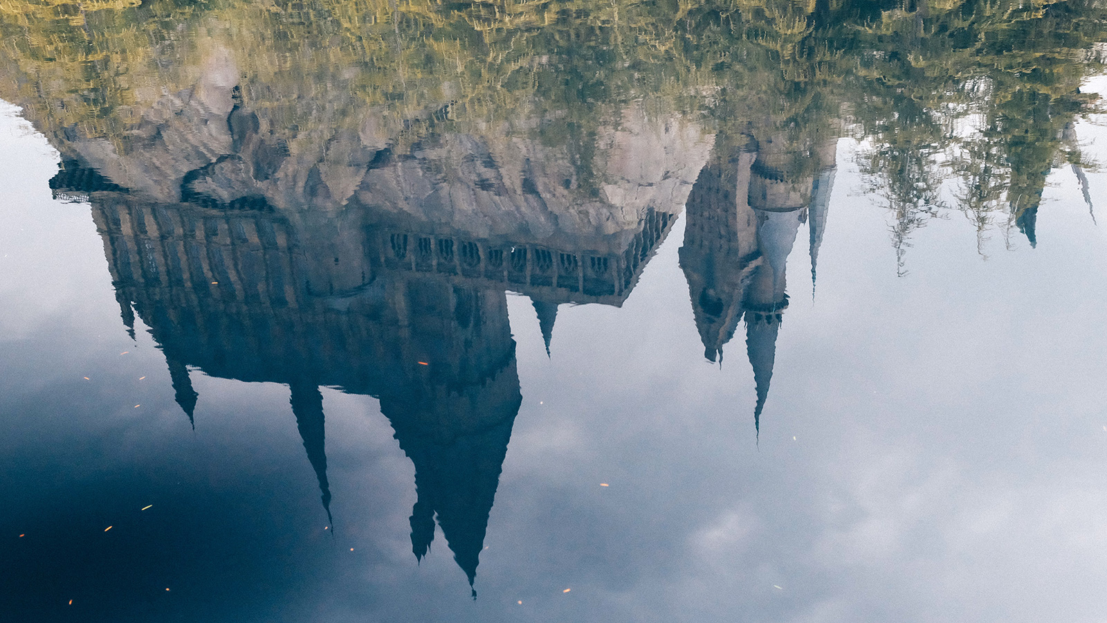 A reflection of Hogwarts Castle in a body of water.